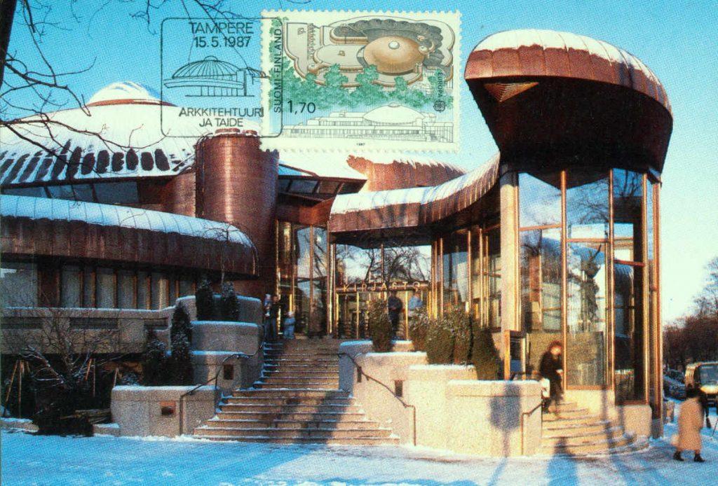 Tampereen Metso-kirjasto postikortissa, postimerkissä ja erikoisleimassa vuonna 1987.